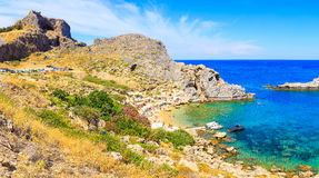 Bay St. Paul and Acropolis of Lindos. Bottom view. Rhodes Greece. Bright Sunny day and the beach. Stock Image