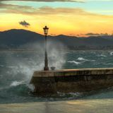 Bay strong waves. Street lamp detail with strong waves in the Santander Bay (Spain royalty free stock photography