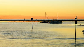 Bay at sunset Stock Photos