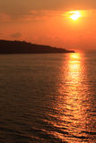 Bay Sunset. Coast interupts setting sun across bay in Sorrento, Italy Royalty Free Stock Image