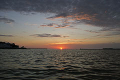 Bay. At sunset contrast clouds, beautiful sun Royalty Free Stock Photography