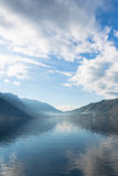Bay Surrounded by Mountains. Early misty morning on the Kotor bay with sea and mountain views Montenegro Stock Photography