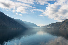 Bay Surrounded by Mountains. Early misty morning on the Kotor bay with sea and mountain views Montenegro Royalty Free Stock Photos