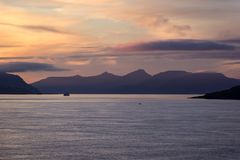 Bay of Torshavn, Faroe Islands, during the sunset. Entrance by ferry Norroena to the Bay of Torshavn, Faroe Islands. There is a romantic and quiet mood during royalty free stock photo