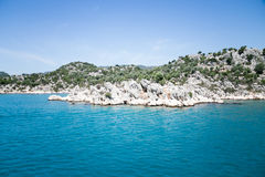 Bay of Uchagiz view from sea. Bay of Uchagiz village in Antalya province of Turkey with mountains covered by evergreen bushes shut on sunny day p Stock Photography