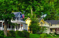 Bay View homes. BAY VIEW, MI - JUNE 26, 2014: Quaint old homes, many of them providing tourist lodgings, line the shady streets of this one-time Methodist Royalty Free Stock Photos