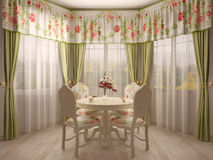 Bay window with dining table Stock Images