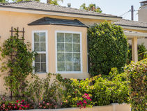 Bay window. Surrounded by flowers and shrubs Royalty Free Stock Image