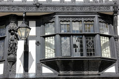 Bay window in Tudor building. Chester. England. Detail of a bay window in Traditional Black-and-white timbered Tudor building in Eastgate Street.  Chester Stock Image