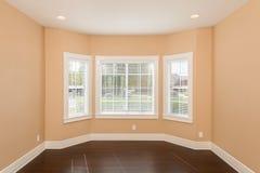 Bay Window Vacant Room. Vacant room with hardwood floor and bay windows Stock Image