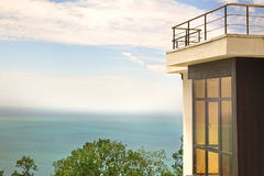 Bay Window In Villa White Concrete Wall And Roof Terrace. Bay Window In Modern Villa White Concrete Wall And Open Air Roof Terrace Over Sea View With Blue Sky Royalty Free Stock Photo