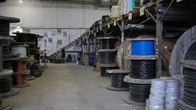 Bay with wires in the warehouse. Cable factory stock video footage