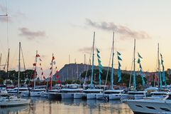 The bay with yachts is surrounded by low hills. Stock Photo