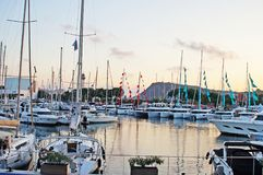 The bay with yachts is surrounded by low hills. Royalty Free Stock Images