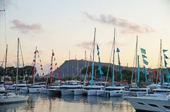 The bay with yachts is surrounded by low hills. Royalty Free Stock Image