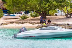 BAYAHIBE, DOMINICAN REPUBLIC - MAY 21, 2017: The boat near the shore. Copy space for text. BAYAHIBE, DOMINICAN REPUBLIC - MAY 21, 2017: The boat near the shore royalty free stock photo