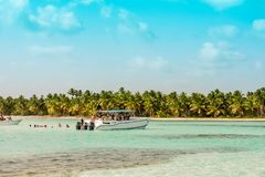 BAYAHIBE, DOMINICAN REPUBLIC - MAY 21, 2017: Boat with people near the shore. Copy space for text. BAYAHIBE, DOMINICAN REPUBLIC - MAY 21, 2017: Boat with people stock image