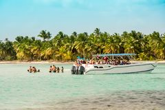 BAYAHIBE, DOMINICAN REPUBLIC - MAY 21, 2017: Boat with people near the shore. Copy space for text. BAYAHIBE, DOMINICAN REPUBLIC - MAY 21, 2017: Boat with people royalty free stock photos