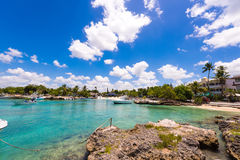 BAYAHIBE, DOMINICAN REPUBLIC - MAY 21, 2017: Boats near the rocky shore. Copy space for text. BAYAHIBE, DOMINICAN REPUBLIC - MAY 21, 2017: Boats near the rocky royalty free stock images
