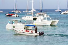 BAYAHIBE, DOMINICAN REPUBLIC - MAY 21, 2017: The boats near the shore. Copy space for text. BAYAHIBE, DOMINICAN REPUBLIC - MAY 21, 2017: The boats near the stock image
