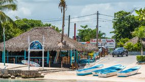 BAYAHIBE, DOMINICAN REPUBLIC - MAY 21, 2017: View of the building near the shore. Copy space for text. BAYAHIBE, DOMINICAN REPUBLIC - MAY 21, 2017: View of the stock photos