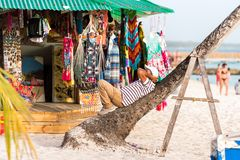 BAYAHIBE, DOMINICAN REPUBLIC - MAY 21, 2017: View of the souvenir shop on the sandy beach. Copy space for text. BAYAHIBE, DOMINICAN REPUBLIC - MAY 21, 2017 Royalty Free Stock Photos