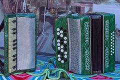 Bayan and accordion green on the table. Front view stock photo