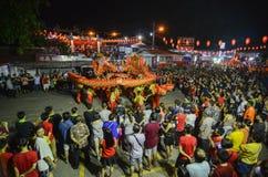 Chinese New Year Dragon Dance at snake temple, Penang. BAYAN BARU, PENANG/MALAYSIA – February 02 2016: Chinese New Year Dragon Dance at snake temple, Penang royalty free stock photography