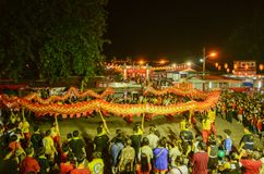 Dragon dance performance at outdoor snake temple. BAYAN BARU, PENANG/MALAYSIA – February 02 2016: Dragon dance performance at outdoor snake temple royalty free stock photo