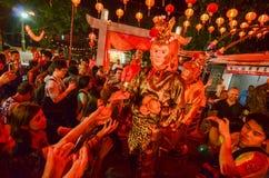 Monkey god give mandarin oranges to chinese who visit snake temple during chinese new year celebration. BAYAN BARU, PENANG/MALAYSIA – February 02 2016 stock photos