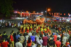 Traditional dragon dance and performance in Chinese culture at snake temple. BAYAN BARU, PENANG/MALAYSIA – February 02 2016: Traditional dragon dance and stock photos