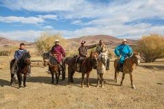Kazakh Eagle hunters on horseback. Stock Image