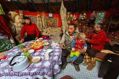 Kazakhs family of hunters with hunting golden eagles inside their the mongolian Yurts. Royalty Free Stock Photography