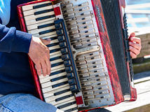 Bayan player is playing on the vintage accordion Stock Photos