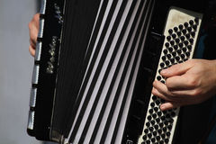 Bayan - Russian accordion. Playing a musical instrument accordion Royalty Free Stock Photography
