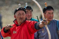 Bayan-Ulgii, Mongolia - October 01, 2017: Traditional Golden Eagle Festival, Archery Competitions. Unknown Bowman In Red Robe Stock Photo