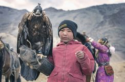 Young kazakh eagle hunter with his bird stock image