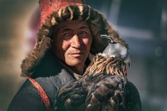 Bayan-Ulgii, Western Mongolia - October 07, 2018: Nomad Games, Golden Eagle Festival. Portrait Of Mongolian Nomad With A Tired And royalty free stock photos