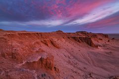 Bayanzag flaming cliffs at dawn. Photo of the Flaming cliffs in Mongolia, found in the Gobi Desert region taken during dawn stock photography