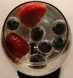 Bayas en burbujas Fotos de archivo
