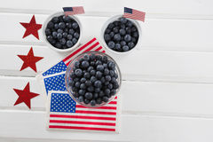 Bayas negras adornadas con tema del 4 de julio Imagenes de archivo