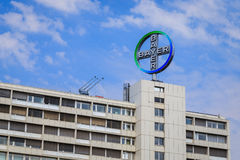 Bayer logo. Logo of Bayer AG, a German chemical and pharmaceutical company, on top of highrise building Stock Image