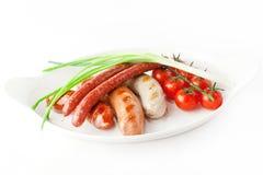Bayerische Würste mit Gemüse Stockbild
