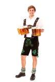 Bayerischer Service mit Bier Lizenzfreies Stockfoto