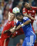 Bayern Munich vs. Chelsea FC UEFA CL Final. MUNICH, May 19 - Drogba of Chelsea (M) between Schweinsteiger (L) and Boateng (R) of Bayern during FC Bayern Munich Royalty Free Stock Photos