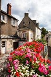 Bayeux homes on the canals. This is the Bayeux town centre during the summer, unique architecture and history bring many tourists to the town. Bayeux, France Royalty Free Stock Photos