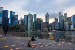 Bayfront Singapore Skyline View. Singapore, Singapore - September 12, 2014: Tourists arrive at Bayfront and find seating early for the colorful Marina Bay Sands Stock Photo