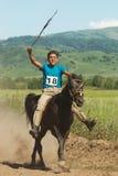 Bayga - corsa di cavalli tradizionale del nomade Fotografie Stock Libere da Diritti