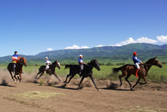 Bayga - traditional nomad horses racing Royalty Free Stock Photography