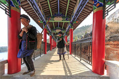 Bayi women walking in the complex of the Heyang Temple in Heqing, Yunnan in China Royalty Free Stock Photos